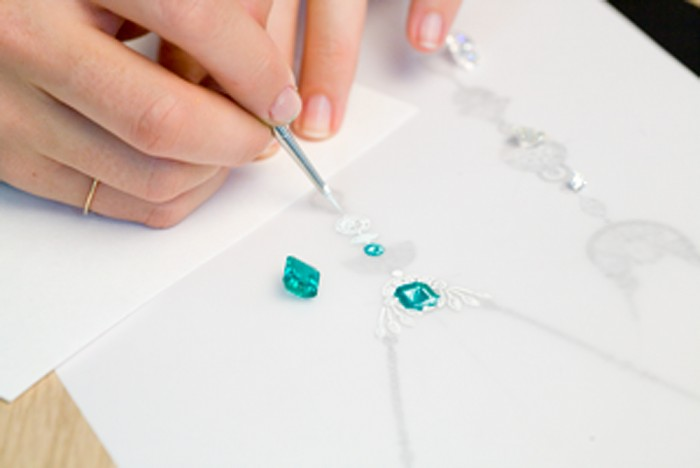 Painting-the-details-on-a-Bespoke-Design-piece-of-jewellery---Emerald-an-dDiamond-necklace-enlarged