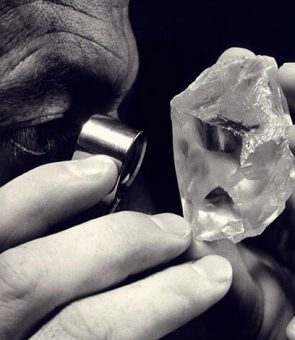 Diamond dealer inspecting rough diamond