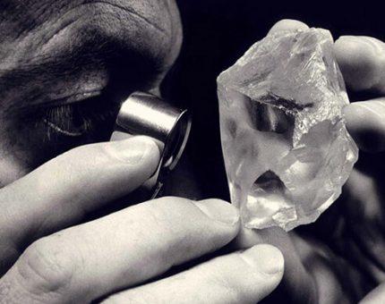 Diamond dealer inspecting rough diamond